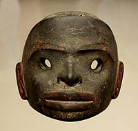 A dark stone mask, free standing