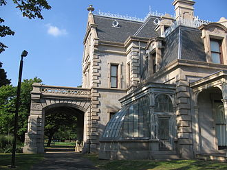 Lockwood–Mathews Mansion - East side of the home seen from the south, showing porte-cochere and greenhouse