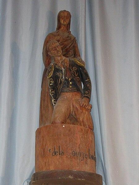 Vierge soutenant un écarteur blessé