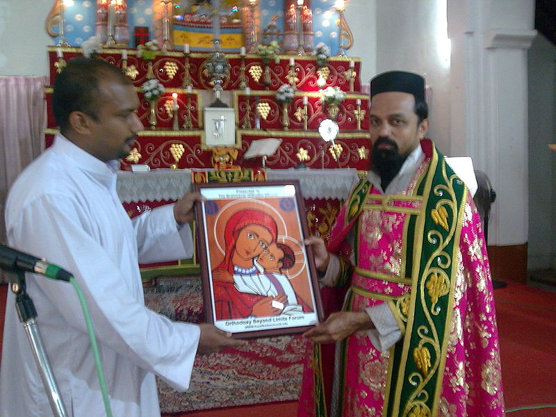 OCP Vice Chairman handing over icon of Holy Theotokos to Fr Crasta as part of the historic Visit to Brahmavar Orthodox Community. November 2009.