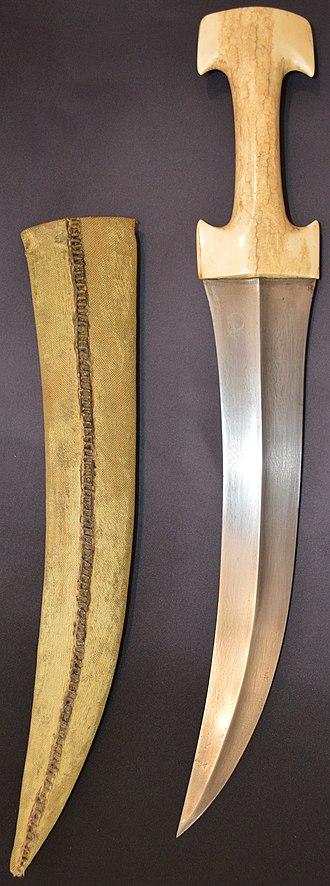Janbiya - Ottoman jambiya (hancer), walrus ivory hilt, damascus steel blade, spiral stitched velvet covered scabbard, 19th century.