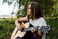 Outdoor acoustic guitar performance (Unsplash).jpg