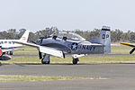 Peter Thomson (VH-DPT) North American T-28D Trojan on the tarmac during the 2015 Warbirds Downunder Airshow at Temora.jpg