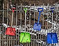 Plastic shovels hanging on fence.jpg