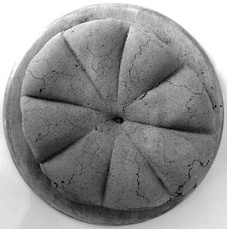 Ancient Roman cuisine - A carbonised loaf of ancient Roman bread from Pompeii. Bread was a staple food in the Roman world.