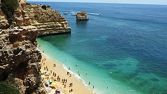 Tourism in Portugal - Marinha Beach. The Algarve region leads in overnight stays.