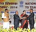 Pranab Mukherjee presenting the National Award for Teachers-2014 to Shri Ram Paul, Himachal Pradesh, on the occasion of the 'Teachers Day', in New Delhi. The Union Minister for Human Resource Development.jpg