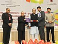 Pranab Mukherjee presenting the Swarna Kamal Award for the Best Film Critic in the category of Best Writing on Cinema to Shri Tanul Thakur, at 62nd National Film Awards Function.jpg