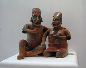 English: Pre hispanic statue of two men drinki...