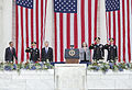 President Barack Obama, left, walks onto the Memorial Amphitheater stage at Arlington National Cemetery in Arlington, Va., to deliver remarks for a Memorial Day service May 27, 2013 130527-D-HU462-197.jpg
