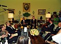 President Bill Clinton meeting with President Jean-Bertrand Aristide of Haiti in the Oval Office.jpg