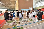 Prime Minister Narendra Modi views a model of the new terminal building at Vadodara.jpg
