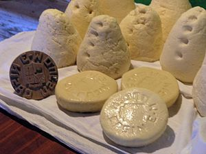 Casín cheese - Three casín cheeses at the front.