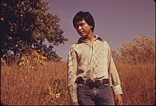 RON MCKINNEY, 22, WHOSE INDIAN NAME IS MAHKUK, IS STANDING IN A VIRGIN TALLGRASS PRAIRIE AREA NEAR WHITE CLOUD AND... - NARA - 557112.jpg