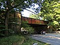 Railroad bridge over Furnace Brook Parkway, August 2018.JPG