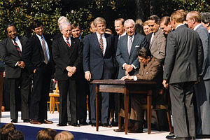 Charles Rangel - Rangel (far left) looks on as President Ronald Reagan signs the Tax Reform Act of 1986 on the White House South Lawn.