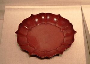 Lacquer - A Chinese six-pointed tray, red lacquer over wood, from the Song Dynasty (960–1279), 12th-13th century, Metropolitan Museum of Art.