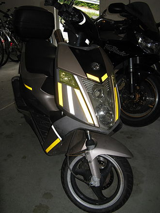 Retroreflective sheeting - Flash photo of moped with Retroreflective sheeting tape