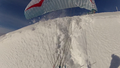 Reverse Launching a Paraglider in Deep Powder Snow at Moderate Wind.png
