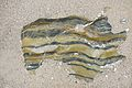 Rock patterns beneath the sand (2770245987).jpg