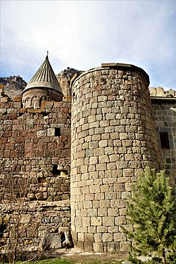 Round tower of the Geghard monastery wall.jpg