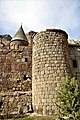 Round tower of the Geghard monastery wall.jpg