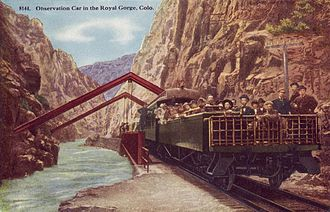 Observation car - Open observation car at the Hanging Bridge of the Royal Gorge on the Denver and Rio Grande Western Railroad in 1918. The enclosed observation car is directly in front of it.