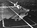 S2F-1 Tracker of VS-24 over USS Valley Forge (CVS-45) in 1960.jpg