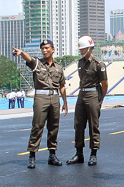 The Singapore Armed Forces Military Police Command providing security coverage at the Padang in Singapore during the National Day Parade in 2000.