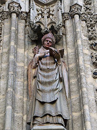 Isidore of Seville - Seville Cathedral. Sculpture of Lorenzo Mercadante de Bretaña