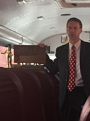 Watertown High School (South Dakota) - Scott Walker, the head coach of forensics at Watertown High School, holding the first place sweepstakes trophy from the State Debate and IE Tournament.