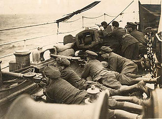 Irish Civil War - National Army soldiers armed with Lewis machine guns aboard an impromptu gunboat in the Civil War