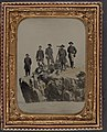 Seven unidentified officers and soldiers in Union uniforms and one officer identified as Major Charles S. Cotter of 1st Ohio Light Artillery Regiment, with telescope, at Point Lookout, Tennessee (9160371478).jpg