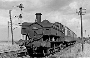 Severn Bridge railway station - Berkeley Rd to Lydney train at Severn Bridge station, looking east, towards the Severn Bridge, hauled by GW '1600' class 0-6-0T No. 1616 (built 12/49, withdrawn 10/59!).