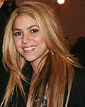 A blonde woman smiling.