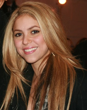 First female performer to win twice, Colombian singer-songwriter Shakira, winner in 2001 and 2018. Shakira2009.jpg