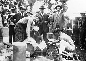 Orange County Sheriff's Department (California) - J. Elliott, Joe Ryan, Sheriff Sam Jernigan, and Undersheriff Ed McClellan shown dumping bootleg liquor, circa 1925.