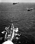 Sikorsky HO4S helicopters of HS-3 fly over a destroyer c1955.jpg