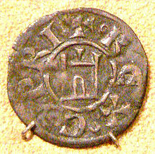 An old coin depicting a building