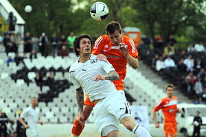 First Professional Football League (Bulgaria) - Georgi Hristov from Slavia (white) playing for the ball against Nikolay Bodurov from Litex (orange) in a 2011 A Group match