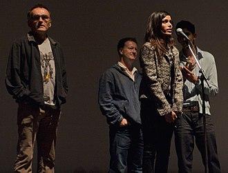 Freida Pinto - Pinto with the crew of Slumdog Millionaire during its screening at the 2008 Toronto International Film Festival