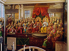 A wall painting of Painting of the Council of Chalcedon, mostly in red and gold paint.