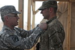 Soldiers earn combat medical badge, pinned by US Army deputy surgeon general 120318-A-GN467-440.jpg