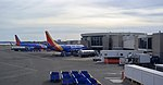 Southwest 737s parked at Terminal A at DCA (39815401742).jpg