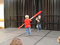 Star Wars Celebration III - the kids take the stage for an impromptu battle (4878259955).jpg
