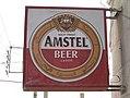 Street sign over liquor shop in Amman (cropped).jpg