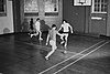 Students playing football in the gym, c1981.jpg