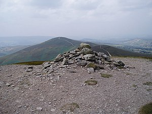 Moel y Gamelin - The cairn atop Moel y Gamelin, with Moel y Gaer and Moel Morfydd in the background