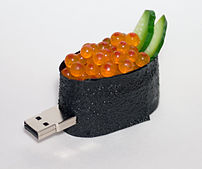 A USB flash drive in the shape of a piece of i...
