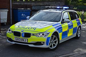 Police vehicles in the United Kingdom - A Sussex Police BMW 330d displaying its visual warning lights